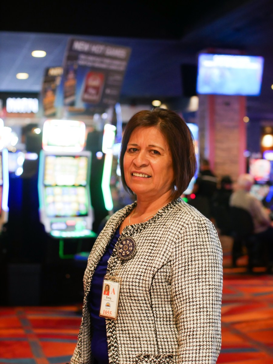 Associate Relations Manager Emily Lauzuon standing in the middle of the casino at Akwesasne Mohawk Casino Resort.