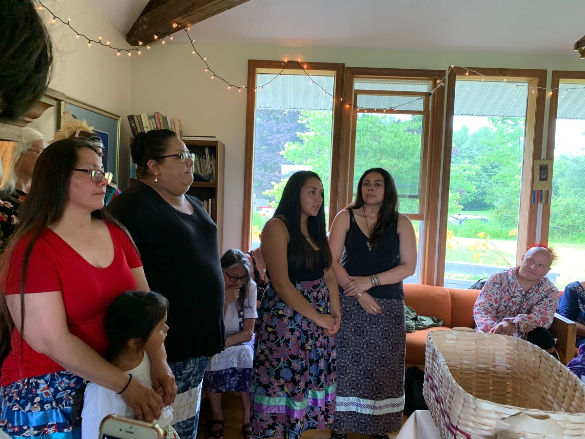 Directors of the organization: (left to right) Marie Schuyler-Dreaver and daughter, the youngest director, Samantha Doxtator, Yuntlekalau McLester and Portia Skenandore-Wheelock. Seated, Joanne Summer Wolf Clan Mother from Canada. (Photo by Buffy Curtis)