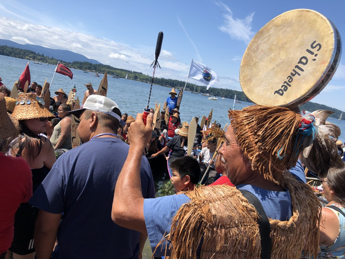 Troy Olsen, Lummi Nation, welcomes canoes to Lummi's shores July 25 during the 2019 Canoe Journey. Lummi Nation expects to host 10,000 guests during the five-day celebration of indigenous cultures.