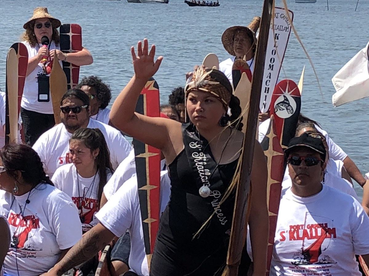 Jayla Moon, Port Gamble S'Klallam, greets the crowds July 25 during the Canoe Journey landing at Lummi Nation.
