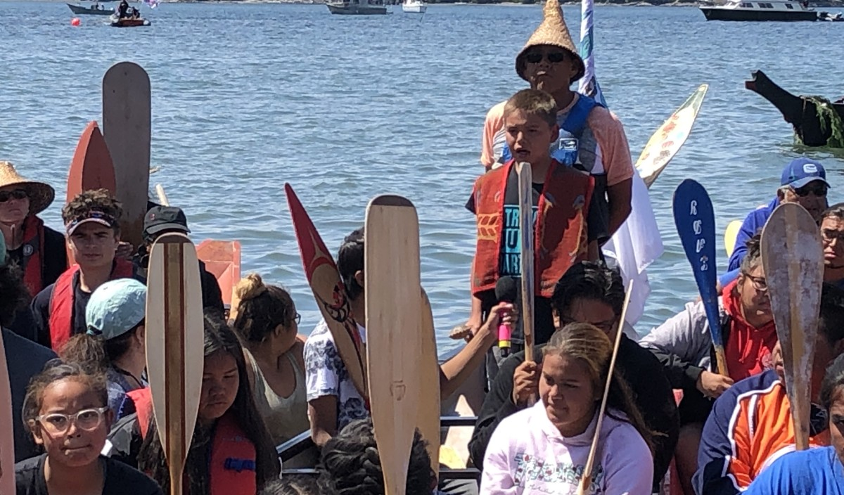 Arnold Thomas, Ahousaht First Nation, sings as part of his canoe family's protocol of asking permission to come ashore July 24 at Lummi Nation for the 2019 Canoe Journey.