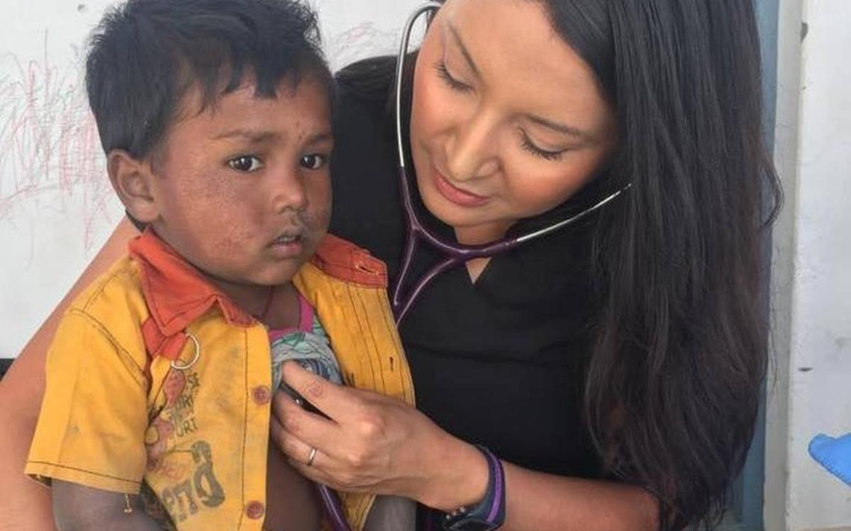 Ciciley Littlewolf treats a boy during a medical service trip in Himachal Pradesh, India. (Courtesy, The Forum)