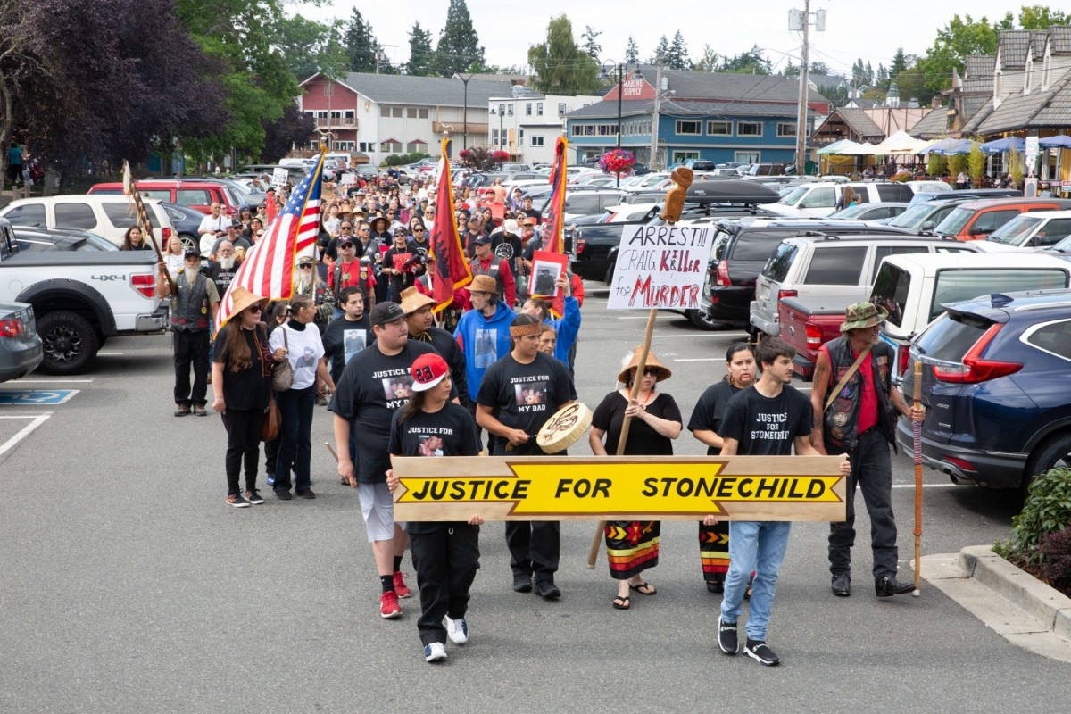 Marchers call for change in the city of Poulsbo, Washington, after the police shooting of a Native man. (Photo by Jay Trinadad)