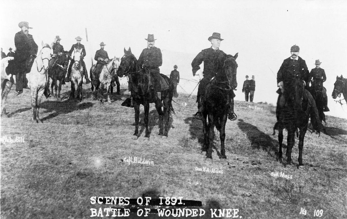 Buffalo Bill, Capt. Baldwin, Gen. Nelson A. Miles, Capt. Moss, and others, on horseback, on battlefield of Wounded Knee. (Photo courtesy: Library of Congress)