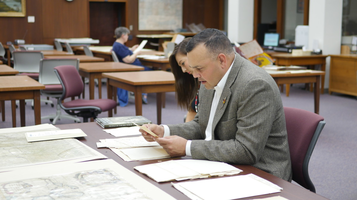Pictured: Lester Randall, Chairman of the Kickapoo Tribe in Kansas, researches Kickapoo tribal history with the help of Rebecca Comfort, American Indian Nations Liaison with the Wisconsin Historical Society, in Madison this past June. Thanks to the historical research efforts of Randall and other tribal members and partners, the Kickapoo Tribe in Kansas will open a Tribal Museum on August 24, 2019.