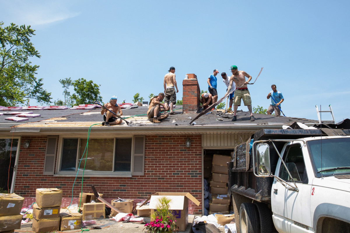 Contractors repair a roof in Beavercreek, Ohio, which was hit by an EF4 tornado in May.