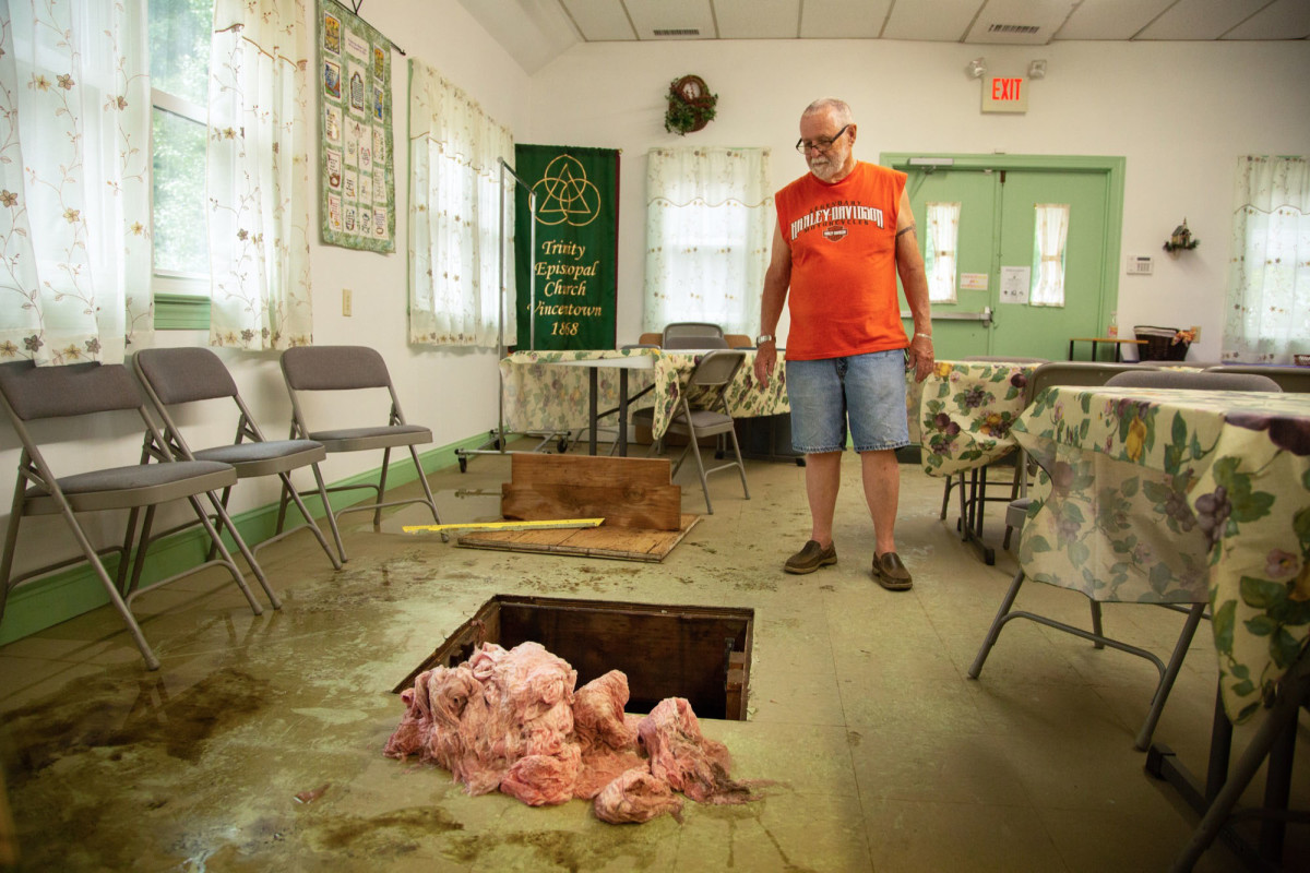 Tom Bridge, 82, is the parish administrator of Trinity Episcopal Church in Vincentown, New Jersey. Flooding this summer caused extensive damage to the church hall, where a pile of soggy insulation remained weeks later.