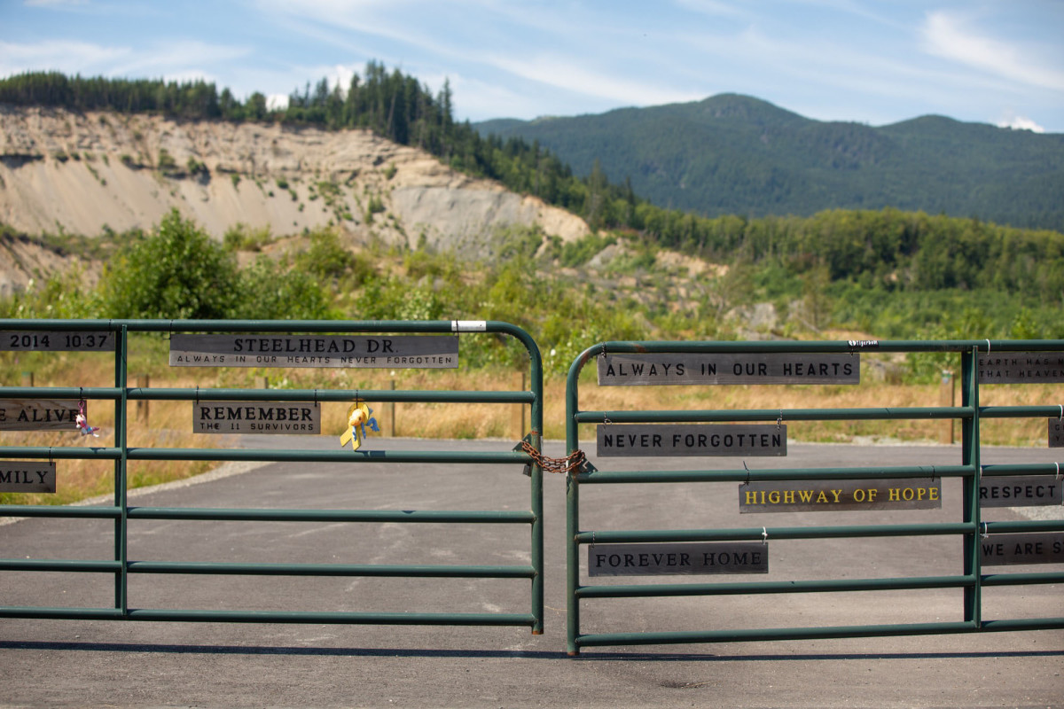Messages of hope and remembrance adorn a fence on Steelhead Road in Oso, Washington, where 43 people died in a 2014 landslide – the largest in U.S. history. The temporary memorial also includes one tree for each person killed that day. In the background, the scar left by the slide is a reminder of the fickle power of nature.
