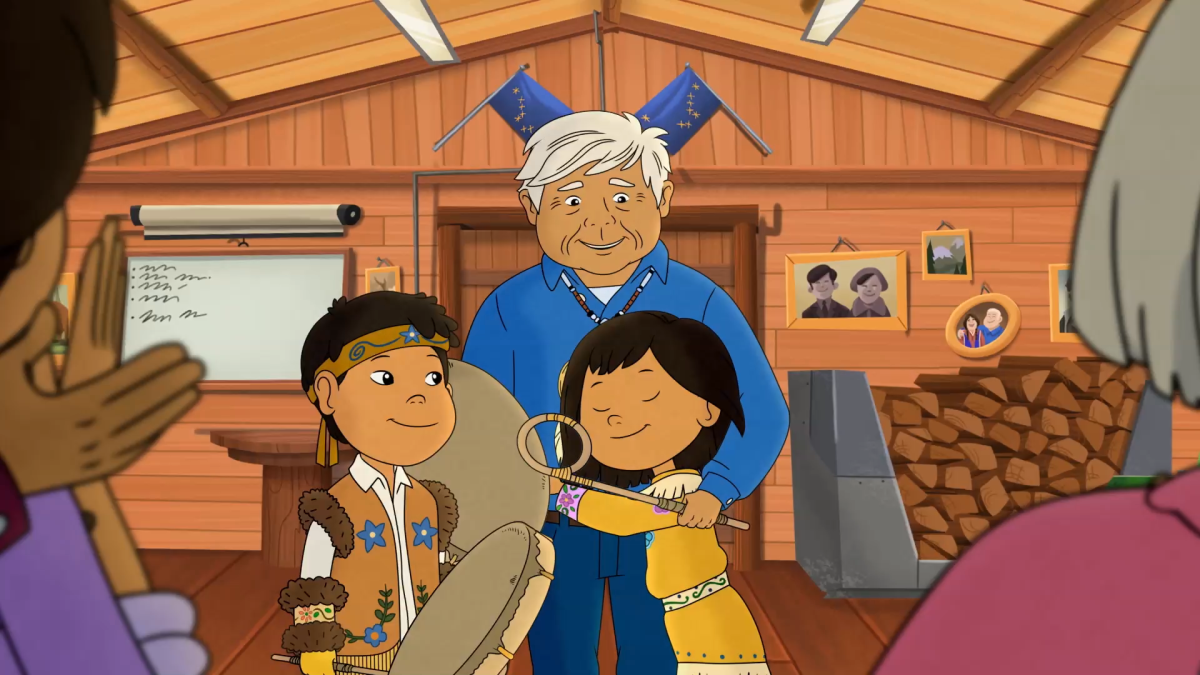 """Pictured: A still from the Molly of Denali story """"Grandpa's Drum."""" Molly finds an old photo of Grandpa as a child and is shocked to see him singing and drumming — Grandpa never sings. When Grandpa tells her he lost his songs when he gave his drum away, Molly goes on a mission to find his drum and return his songs to him."""