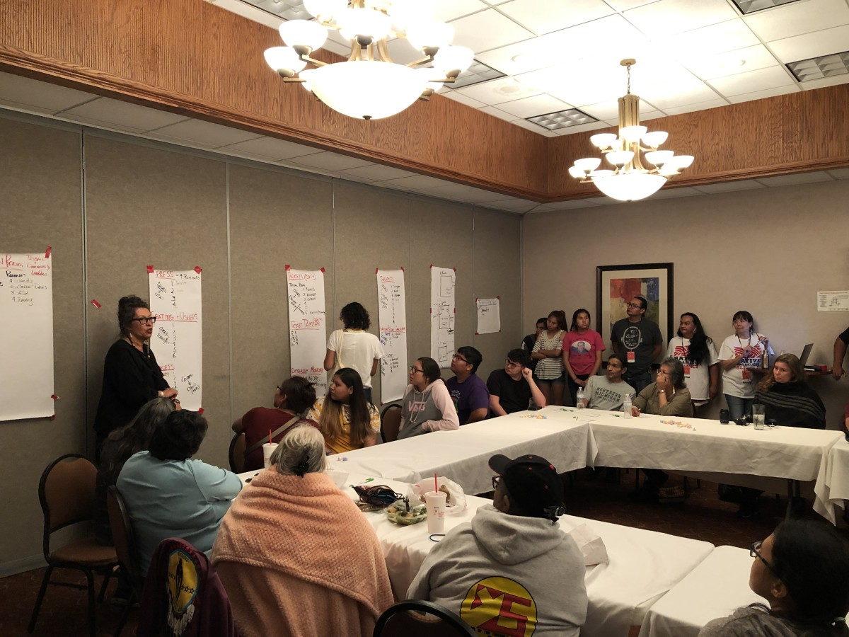 Judith LeBlanc, Caddo, meets with volunteers before the forum began. (Photo by Taylor Notah)