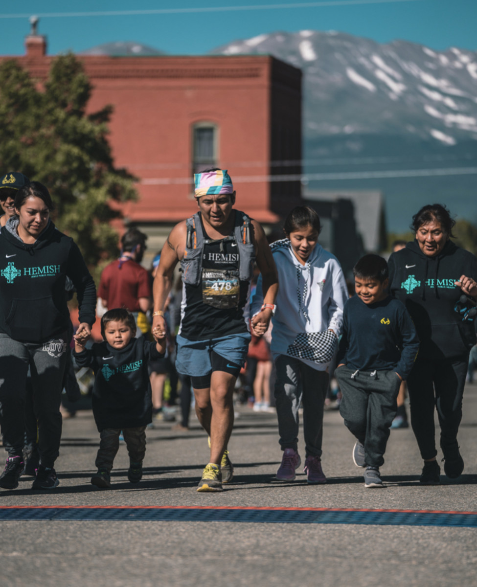 (Part of Daniel Madalena's family as they cross the finish line together. Left to right: Devonna Edmonds, Ares Oliver Madalena, Daniel Madalena, Arianna Madalena, Lliam Madalena, and Gail Romero. Photo byAlec Madalena.)