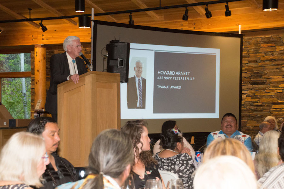 Pictured: Howard Arnett, Esq., of Karnopp Petersen LLP, Bend, Oregon, received the prestigious Twanat Award at The Museum At Warm Springs Huckleberry Harvest Celebration and Honor Dinner at the High Desert Museum in Bend, Oregon on Saturday, August 17, 2019. The award was given in recognition of Arnett's nearly four decades as an attorney for the Confederated Tribes of Warm Springs, and for his representation of other tribes on matters involving treaty rights, tribal sovereignty, Indian law development, government-to-government relations and gaming. Arnett is also a longtime supporter of The Museum At Warm Springs.