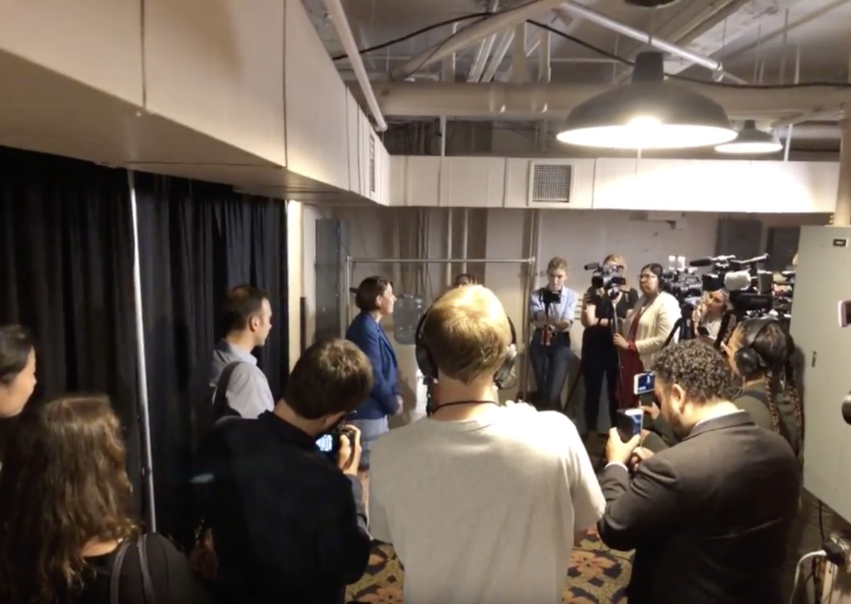 Amy Klobuchar answering questions from the press in the media room.