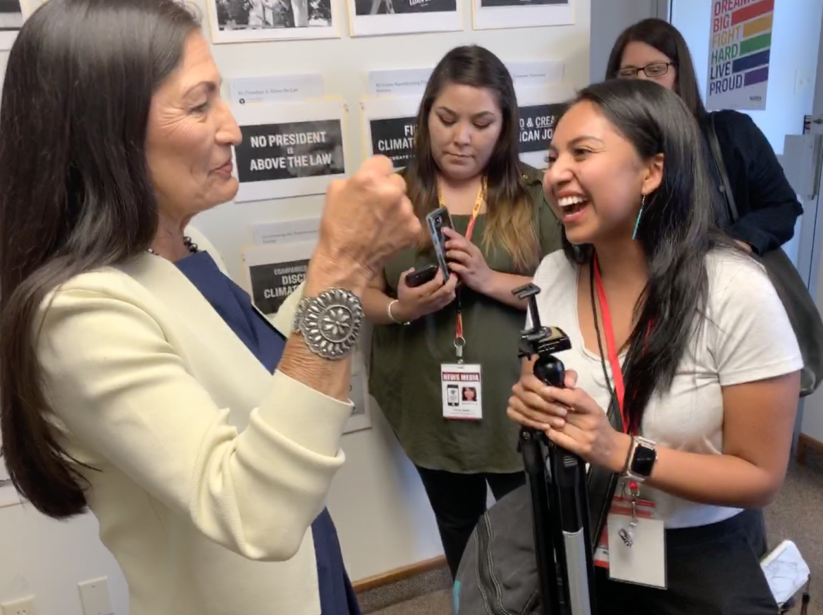 Rep. Deb Haaland and Aliyah Chavez talking about Chavez's late uncle, Everett Chavez of Kewa Pueblo, who used to be one of the 20 governors on the All Indian Pueblo of Governors. Haaland knew him from his work and told Chavez he would be the first to help with the forum.