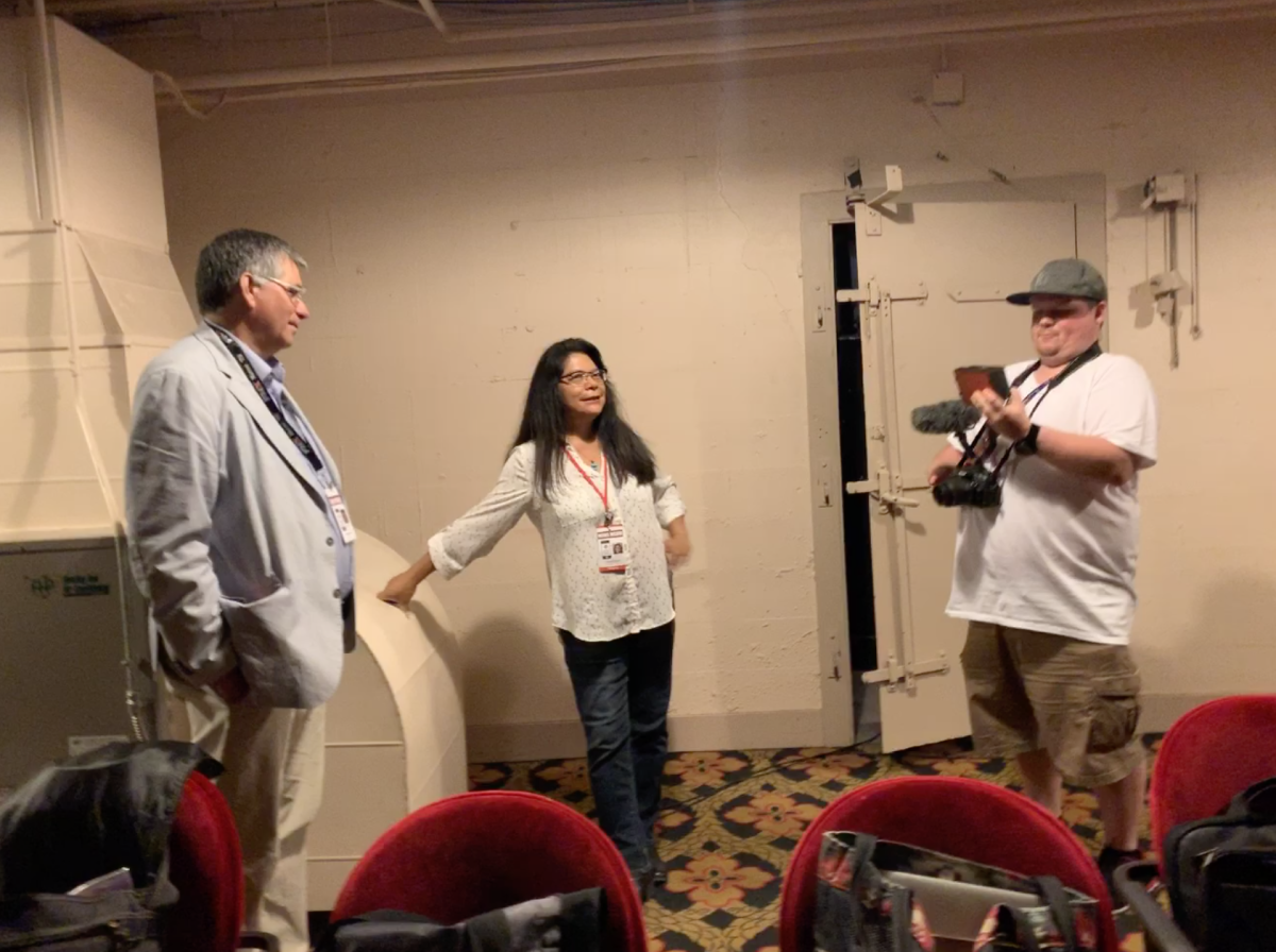 Patty Talahongva and Charlie Perry talking about locations to interview Mark Trahant.