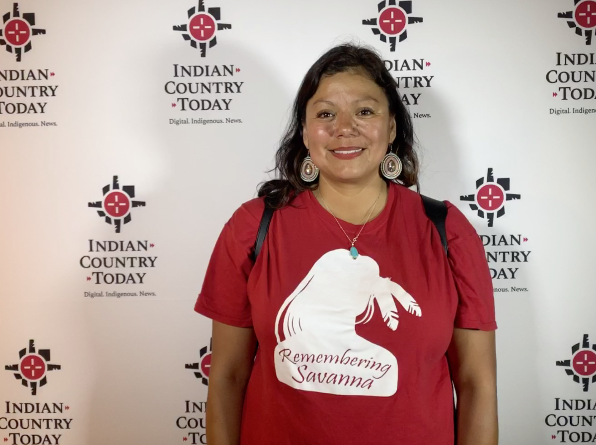 Ruth Buffalo, the first Native Democratic woman elected to the North Dakota Legislature, takes photos the day before the forum.
