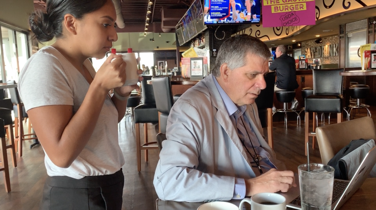 Aliyah Chavez and Editor Mark Trahant quickly look over a story during breakfast on Aug. 18, the day before the forum and before a run through of the venue.