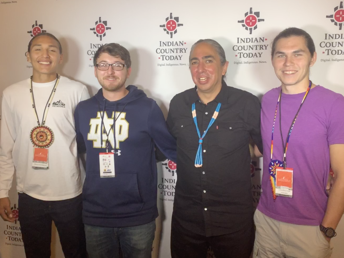 Mark Charles takes a photo with Native youth backstage.