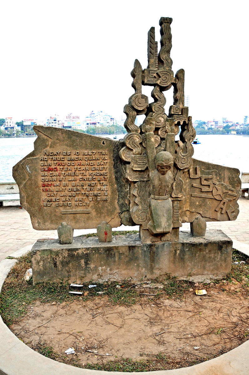 A monument on Truc Bach Lake in Hanoi marks the site where then-Navy pilot John McCain was shot down and captured in 1967, beginning five years as a prisoner of war.
