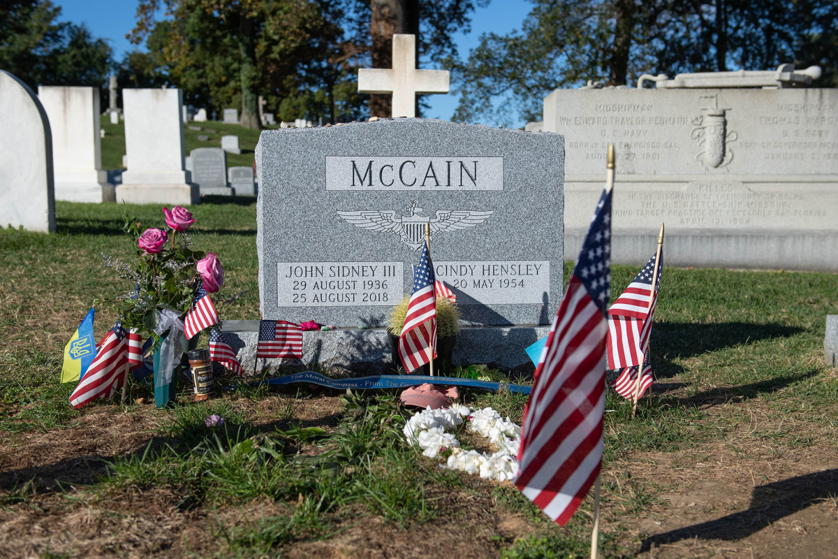 Former Sen. John McCain's grave at the U.S. Naval Academy is next to friend and former classmate, Adm. Chuck Larson. Since his death a year ago, McCain's grave has become a stop for visitors who leave mementos.