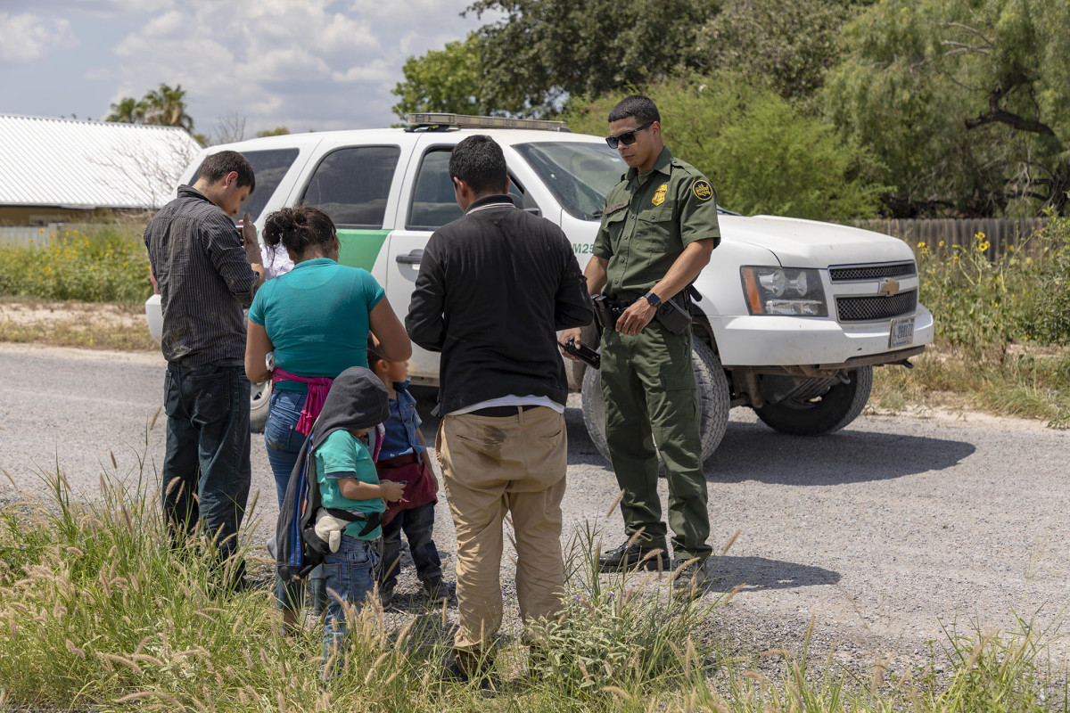 An immigrant family turns itself in to a Border Patrol agent after crossing the Rio Grande to enter the U.S. illegally in June. A Trump administration plan would let authorities hold migrant families together indefinitely, instead of releasing the children in 20 days as is currently required. (Photo by Mani Albrecht/Customs and Border Protection)