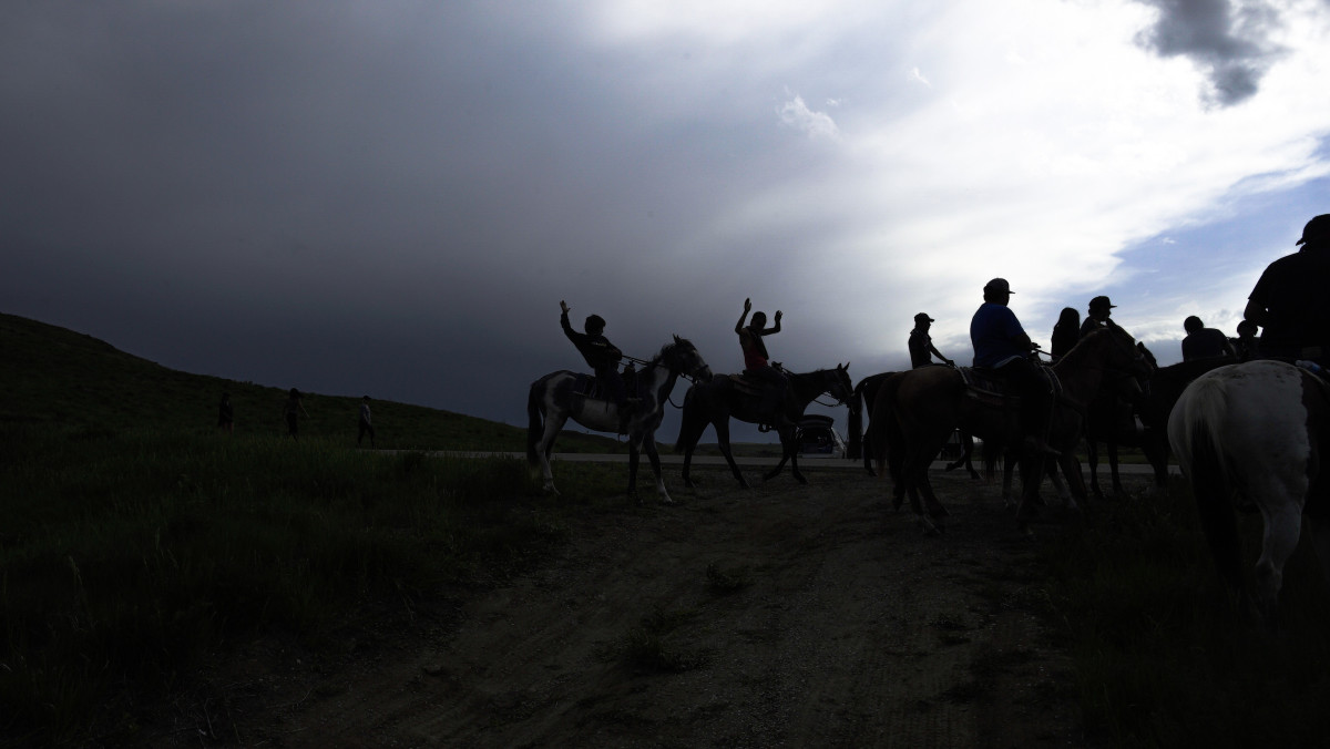 """""""Riders,"""" a photograph by Michelle Latimer, is one of the images taken at the Standing Rock camps and featured in a new anthology, Standing with Standing Rock."""