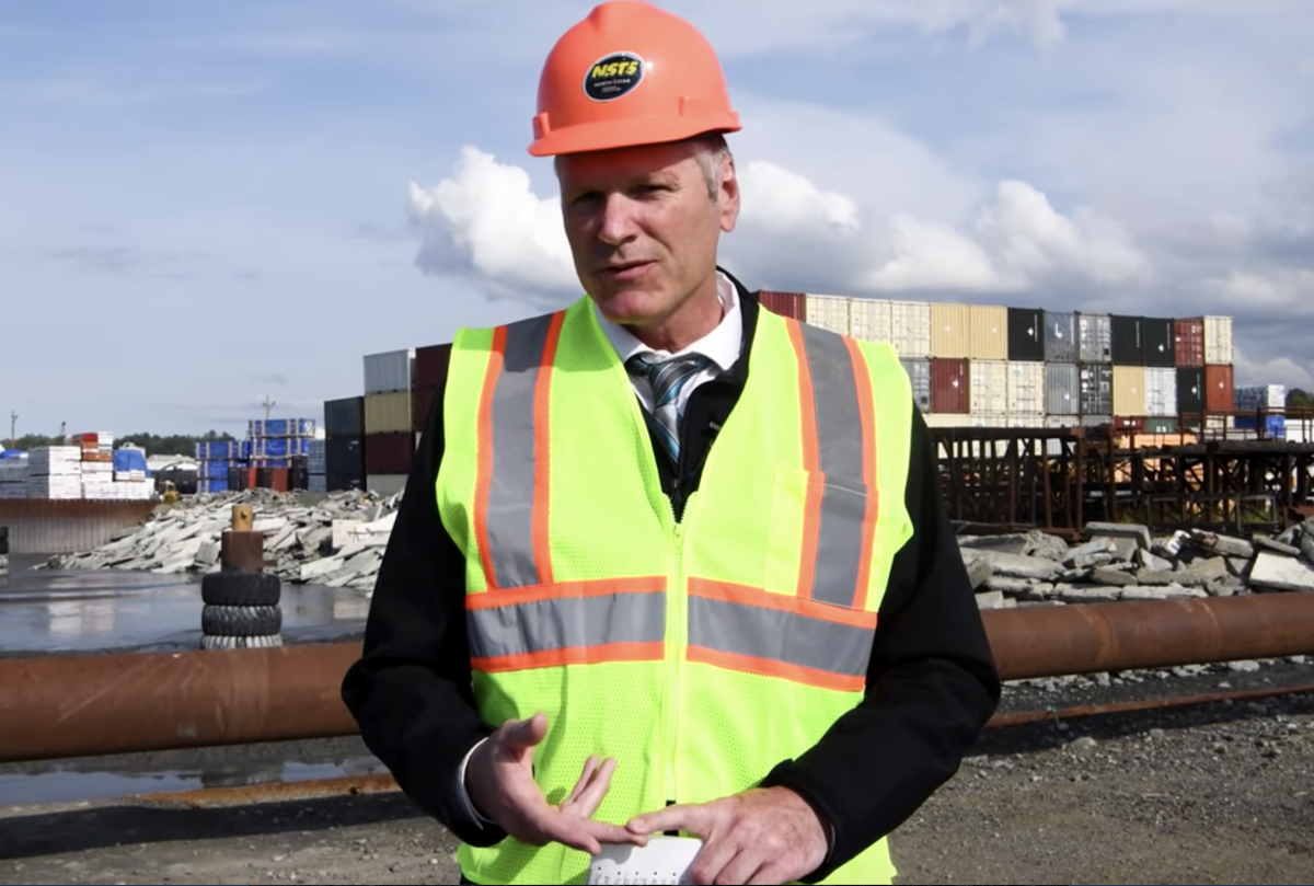 Cover: Screen shot of a video from Governor Mike Dunleavy making a statement on Alaska's economy at the Port of Anchorage Sept. 5, 2019.