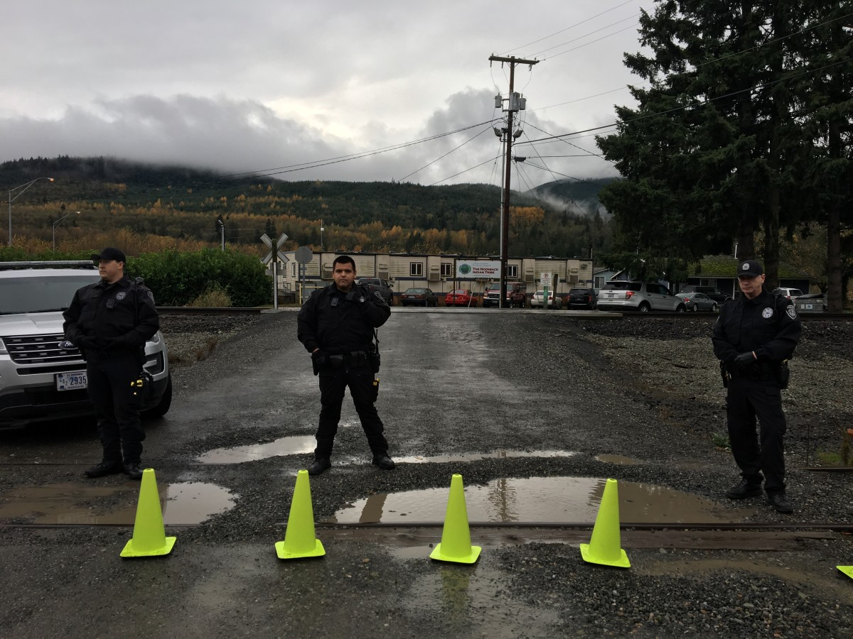 Pictured: Nooksack police blockade near Tribal Court, Mike Ashby at right.