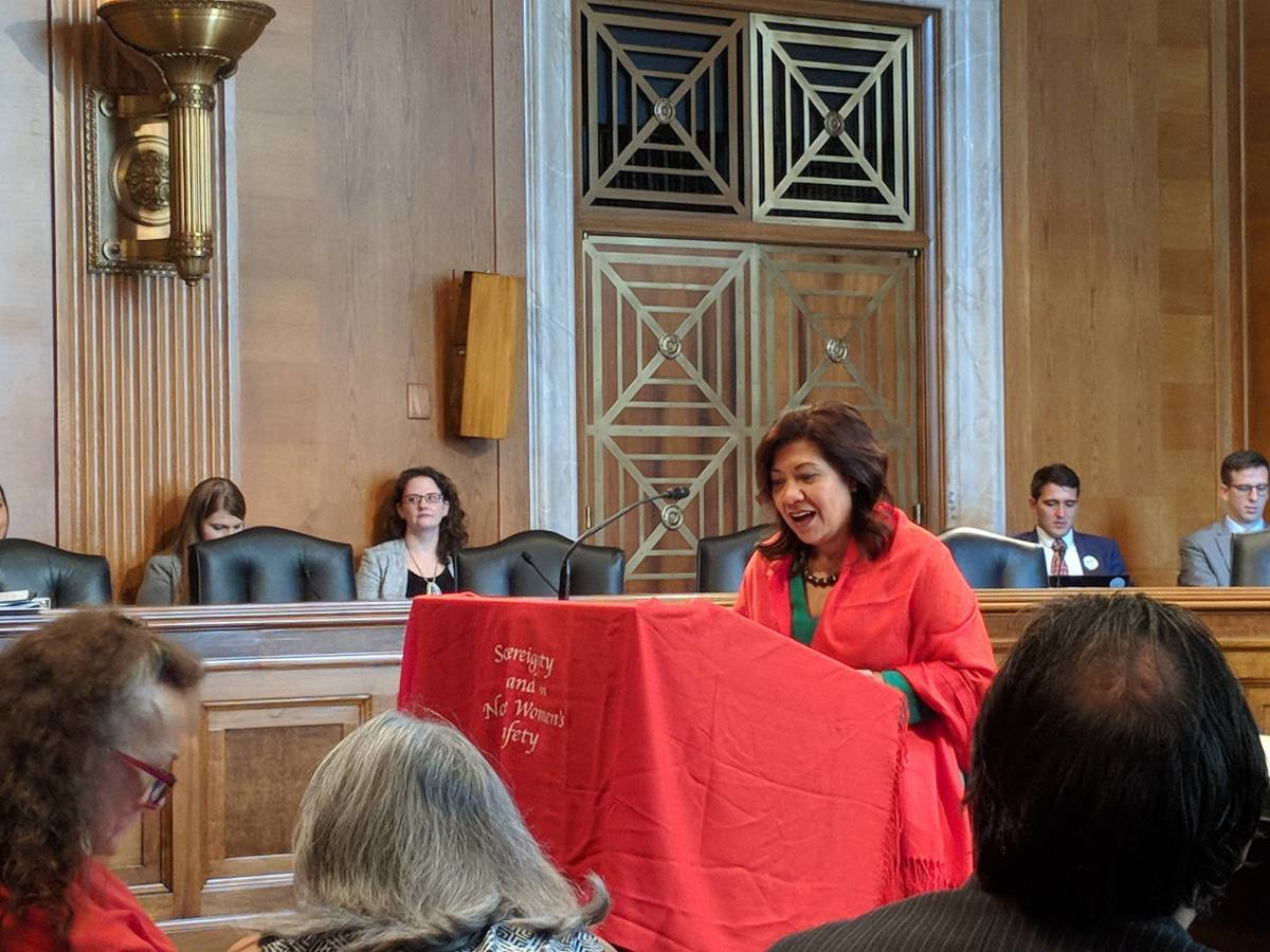 Rep. Norma Torres in her shawl (Photo by Kolby KickingWoman)