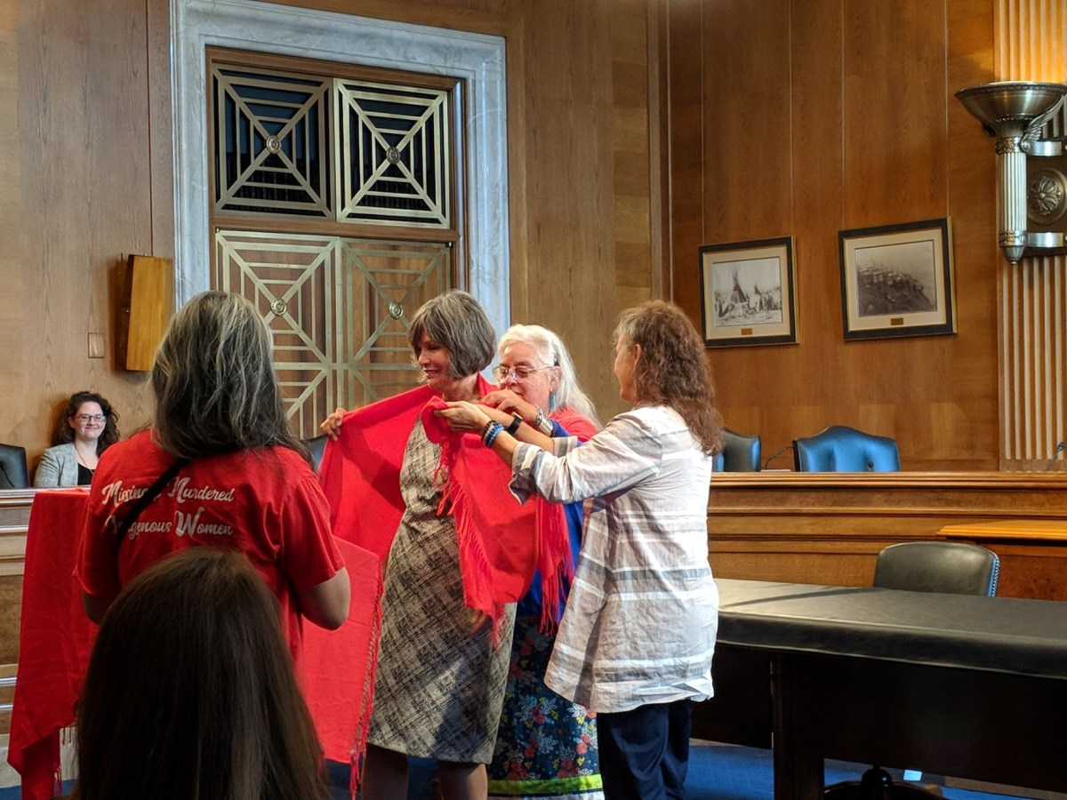 Rep. Betty McCollum has shawl draped over her shoulders (Photo by Kolby KickingWoman)