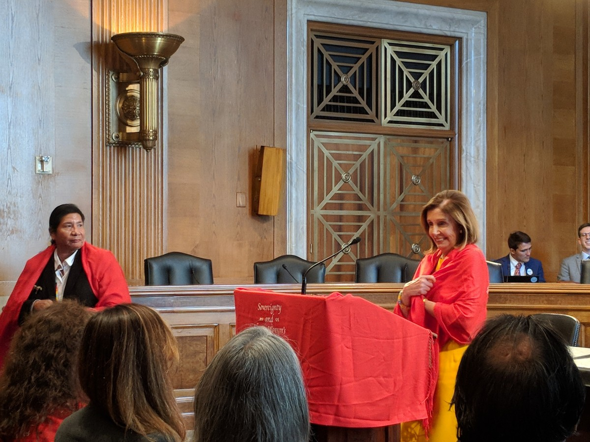 """""""Thanks for the warm welcome,"""" Speaker Pelosi said after being wrapped in shawl (Photo by Kolby KickingWoman)"""