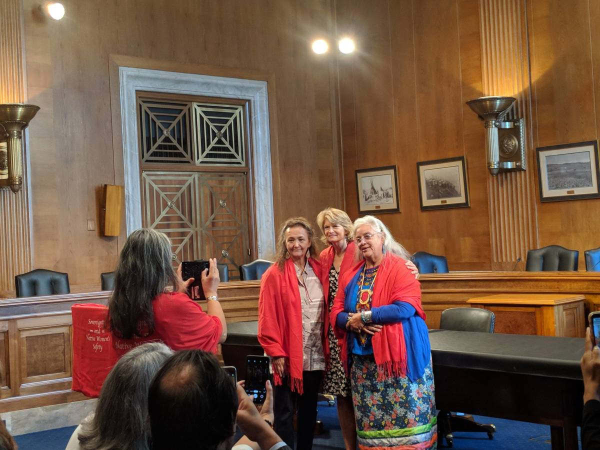 Sen. Lisa Murkowski poses for photo after being gifted shawl (Photo by Kolby KickingWoman)