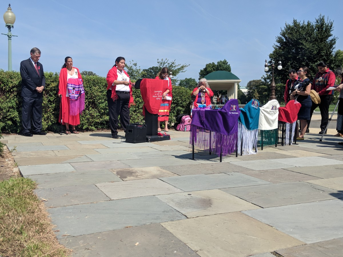 Vice-president of the Oglala Sioux Tribe, Darla Black, closes the Violence Against Women Act press conference with a prayer (Photo by Kolby KickingWoman)