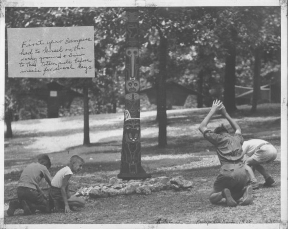 Young scouts bow to a totem pole at the scout camp Kia Kima. Courtesy archive photo