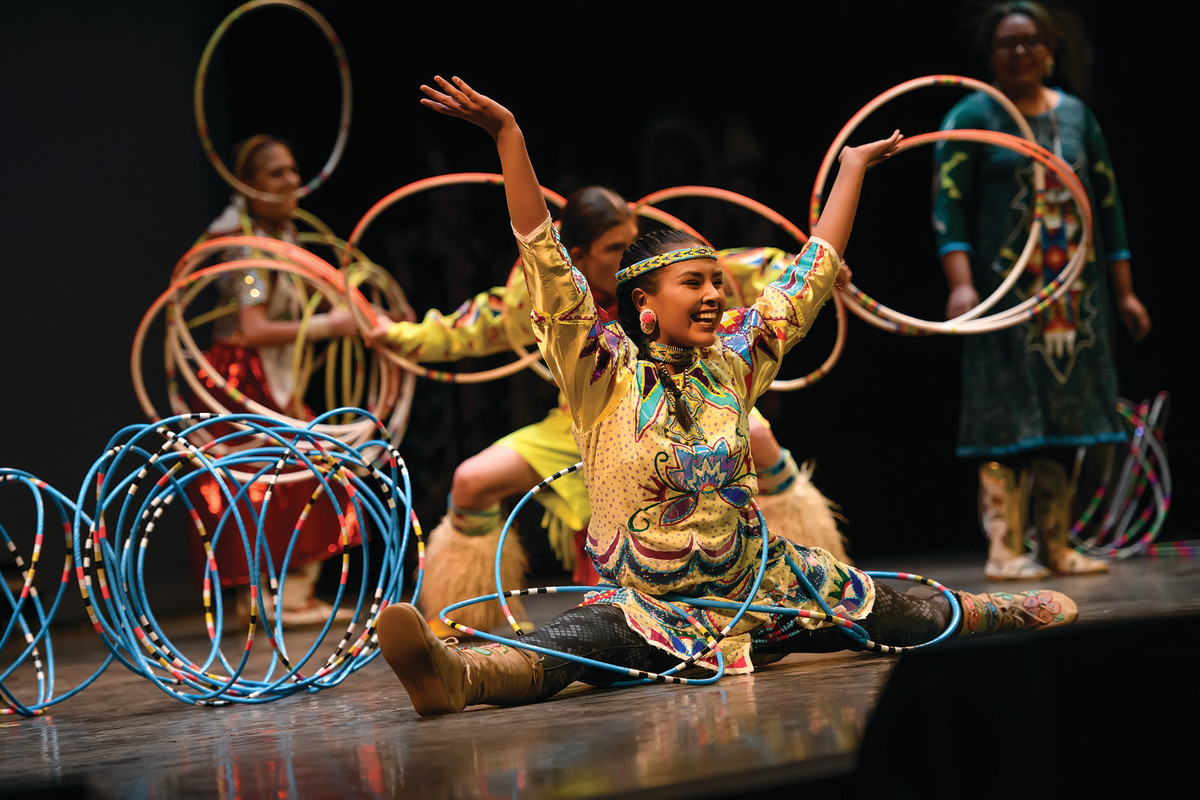 """Pictured: Hoop dancer Amya Spoonhunter dances with the Eagle Spirit Dancers following the WY Wind River Economic Development and Entrepreneurship Symposium. """"Circle of Dance"""" was sponsored by Wyoming Humanities and the University of Wyoming's High Plains American Indian Research Institute."""