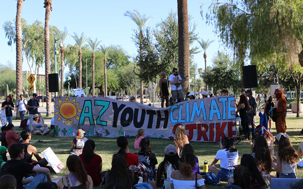 Activists convene on the Arizona Capitol grounds, where many young people spoke about climate change and other social and economic issues. (Photo by Annika Tomlin/Cronkite News)