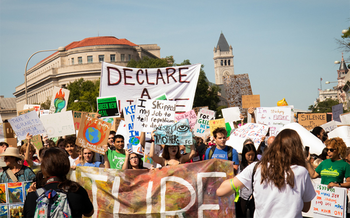 Protesters in Washington, D.C., march toward the U.S. Capitol during Youth Climate Strike on Friday. (Photo by Kailey Broussard/Cronkite News)