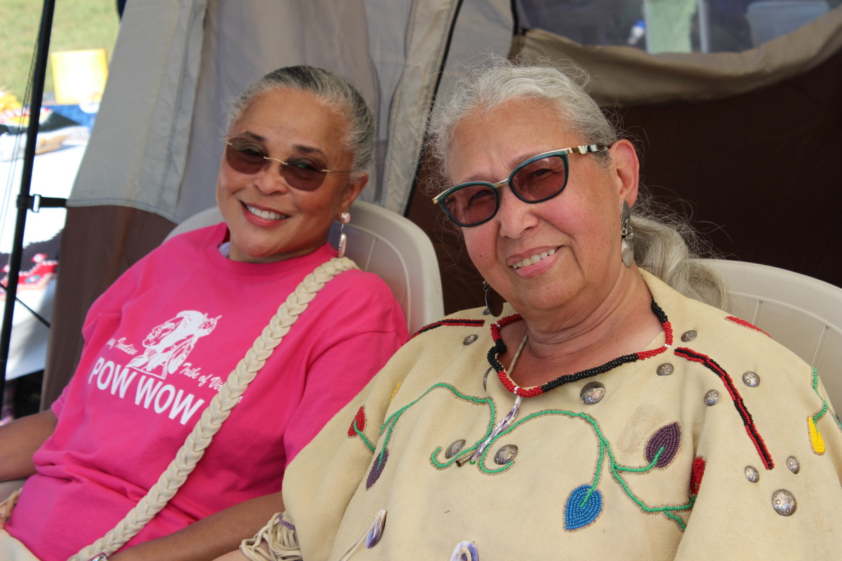 Tribal member Sheila Elliott and Nottoway Indian Tribe of Virginia Chief Lynette Allston take in some of the powwow atmosphere. - Photo: Vincent Schilling