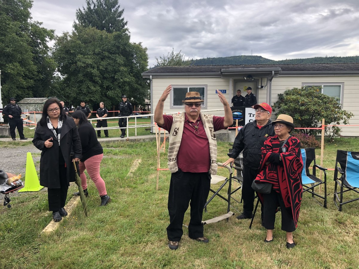 Pictured: George Adams thanks tribal supporters outside of Tribal Court on September 12, 2019.