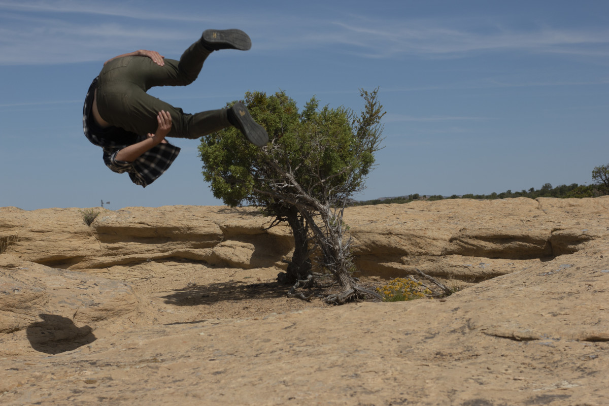 "(Conrad Weitzel, a parkour athlete from Phoenix, practices his stunts near the set of ""For Any Run"" filmed in Pinion, Arizona. Photo by Alisa Banks.)"