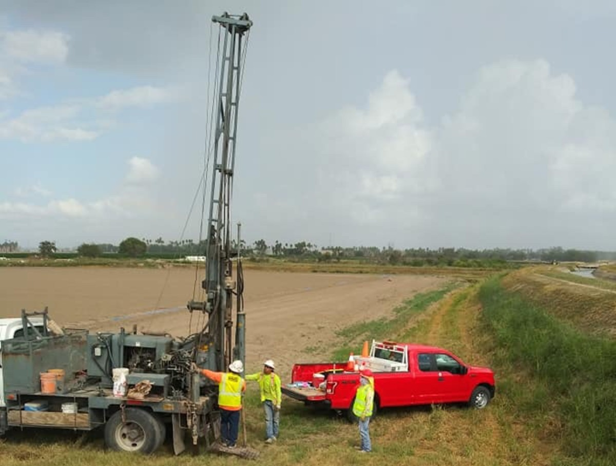 The drilling crew taking core samples on the north side of the levee near the Eli Jackson cemetery. (Photo Courtesy Julia Blackowl)
