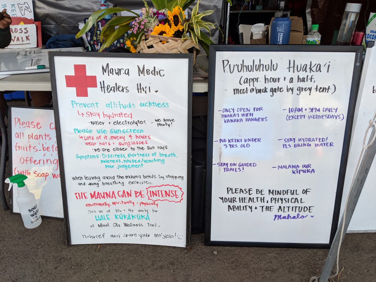 Signage at information station in the Pu'u Huluhulu camp. (Photo by Anne Keala Kelly)