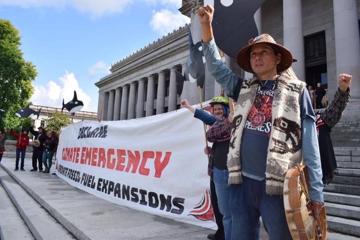 Paul Chiyokten Wagner, leader of the Protectors of the Salish Sea stands vigil on the steps of the Washington state capitol building in Olympia, Washington.