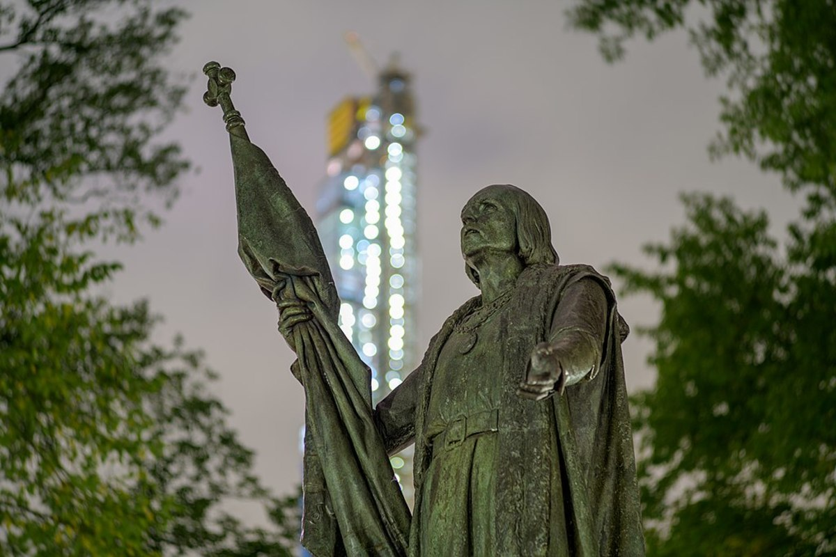Pictured: Christopher Columbus by Jeronimo Suñol, a statue created in 1892, in Central Park with Central Park Tower under construction in the background at night.