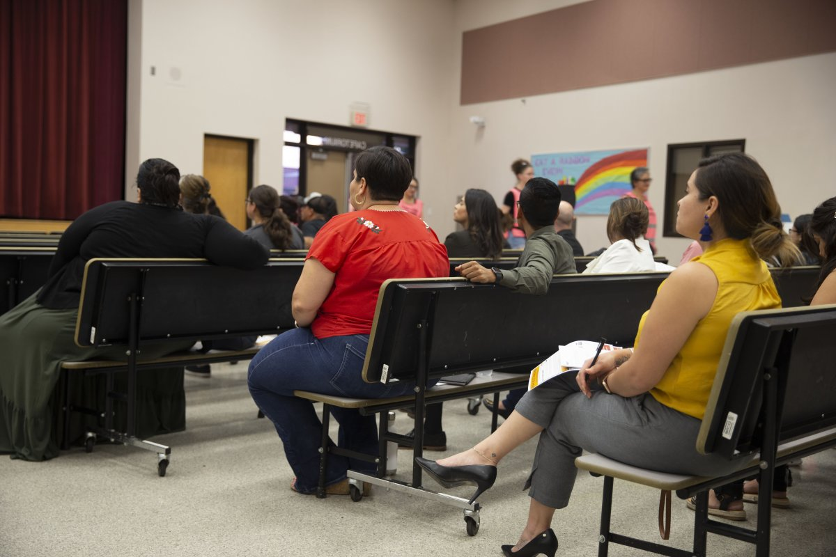 Families and community members listen to a group of immigration attorneys address misconceptions surrounding the public charge law in the cafeteria of Encanto Elementary.
