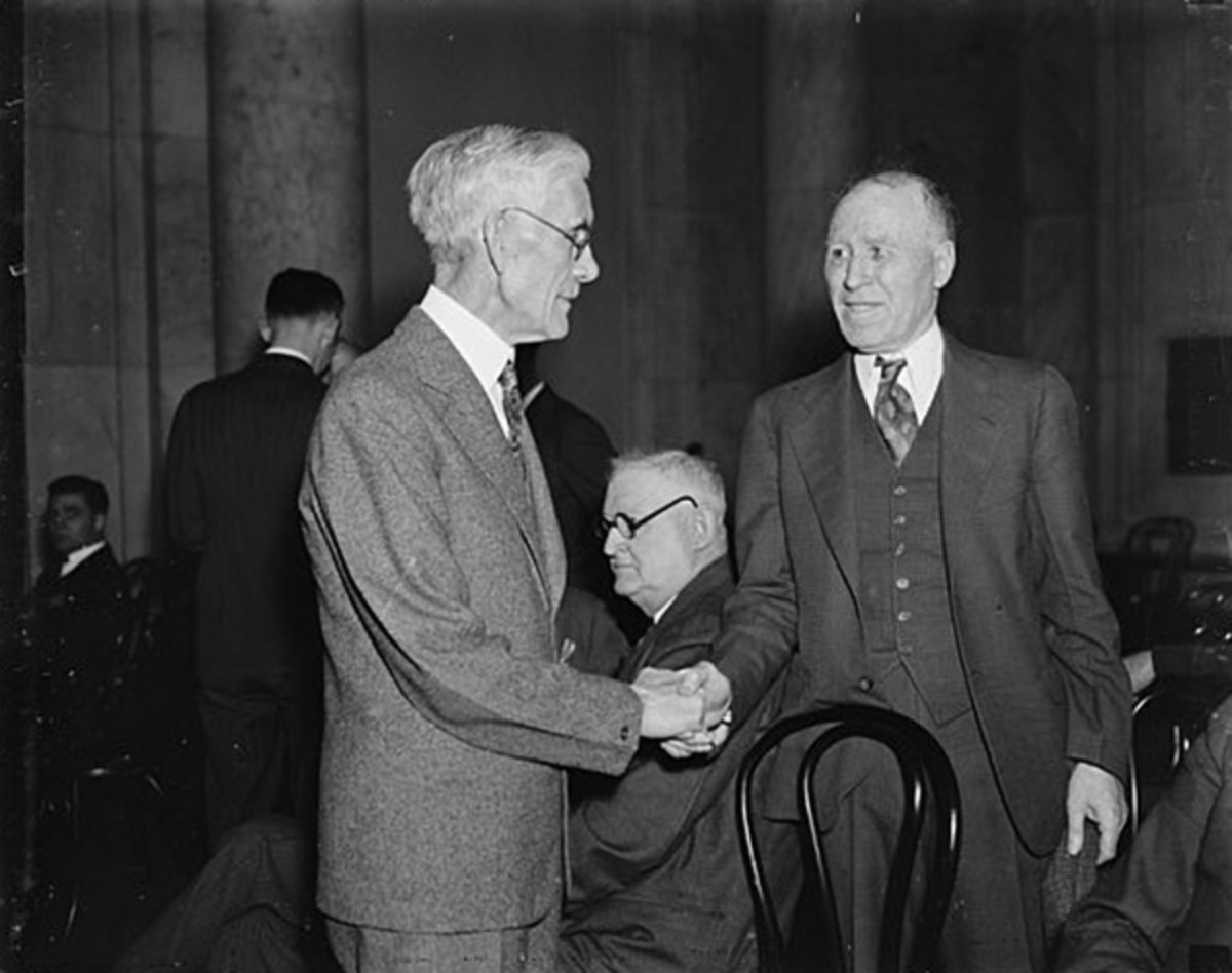"""Pictured: Holds House Committee in contempt. Washington, D.C. January 16, 1937. The Presidential candidate Lemke and his backer Dr. Francis Everett Townsend (left) are shown as they conferred about the new Townsend Plan now to be called the 'General Welfare Bill'. Dr. Townsend who was to go to court on February 8 for contempt charges against him said that day that, """"I have nothing but contempt for the House Committee."""" Townsend organized 'clubs' all over the country to promote his basic income guarantee."""