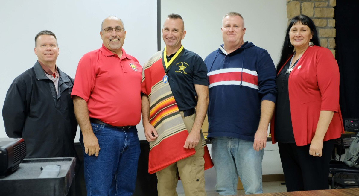 (Left to right): Miami Council person Scott Williard, Chief Douglas Lankford, JP Fulton, Second Chief Dustin Olds and Secretary Treasurer Donya Williams pose with Fulton after presenting him with a blanket and medal for his work in returning remains to the tribe.