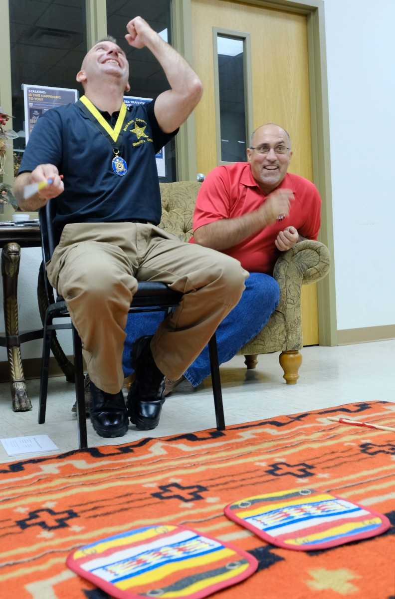 JP Fulton enjoys a round of the moccasin game with Chief Lankford on his team at Miami tribal headquarters in Oklahoma.