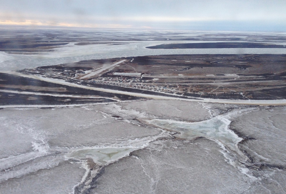 Aerial view of Tuntutuliak a Yup'ik village located 40 miles southwest of Bethel, a regional hub community on the Kuskokwim River in western Alaska. Hundreds of villages in rural Alaska are not linked by road to any other community. Such villages are accessible only by boat, snow machine, four-wheeler, vehicles, or aircraft. In winter, people use frozen rivers for travel. (Photo by Joaqlin Estus)