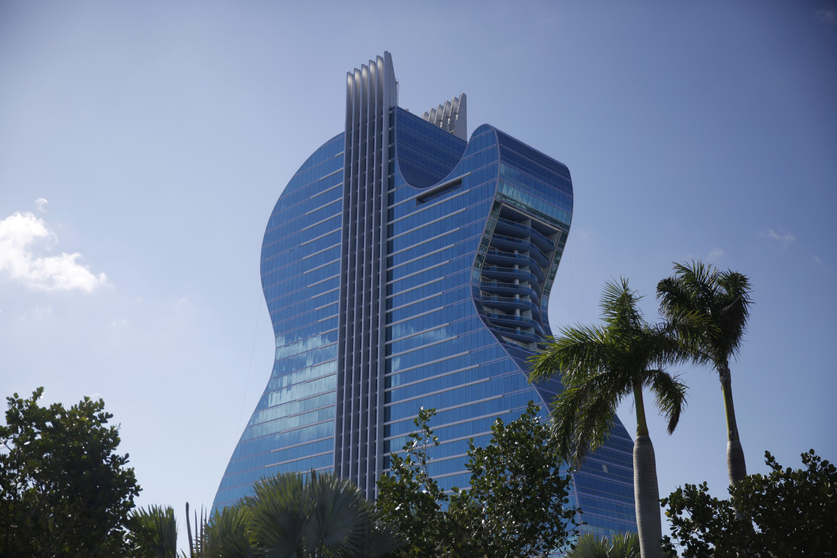 The guitar-shaped hotel is seen at the Seminole Hard Rock Hotel and Casino on Thursday, Oct. 24, 2019, in Hollywood, Florida. The Guitar Hotel's grand opening is on the tribe's land in Hollywood. It's the latest step in the Seminole Hard Rock empire, which includes naming rights on the Miami-area stadium where the 2020 Super Bowl will be played. (AP Photo/Brynn Anderson)
